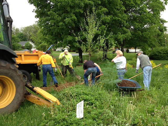 Gross McGinley Volunteers Plant Trees Along Cedar Creek Parkway in Allentown